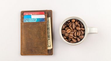 Wallet with credit cards next to coffee mug